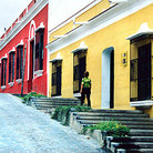 Picture - Colorful, restored buildings line streets near Plaza Bolivar in Colonial Quarter of Ciudad Bolivar.
