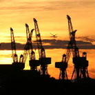 Picture - Cranes in the sunset at a Clyde shipyard, Glasgow.