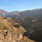 Picture - A river running through the Colca Canyon.