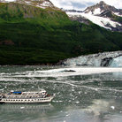 Picture - A tour boat at Havard Glacier in College Fjord.