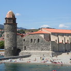 Picture - People on the beach beside the tower of Notre Dame, Collioure.