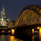 Picture - Bridge and the Dom of Cologne at night.