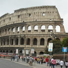 Picture - Tourists throng outside the Colosseum in Rome.