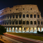 Picture - Colosseum at night with car lights in Rome.