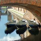 Picture - Boats and bridge in Comacchio.