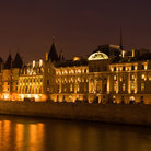Picture - Night view of the Conciergerie on the Seine River Paris.
