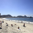 Picture - Soaking up the sun on Copacabana beach.