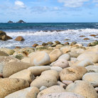 Picture - Large round stones on Porth Nanven beach, Cornwall.