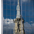 Picture - Reflection of a steeple in the glass windows of a highrise building in Decatur.