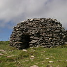 Picture - Prehistoric beehive shaped huts on the Dingle Penninsula.