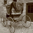 Picture - An old cart parked outside one of the historic buildings in the Distillery District of Toronto.