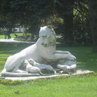 Picture - Marble sculpture of lioness with two cubs in Garden of Dolmabahce Palace in Istanbul.