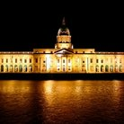 Picture - Dublin Custom House lit up at night.