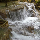 Picture - Water pouring over Dunn's River waterfall.