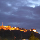 Picture - Edinburgh Castl lit up in the late day.