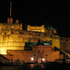Picture - Lights of Edinburgh Castle at night.
