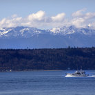 Picture - A boat in front of distant mountains, seen from Edmonds.