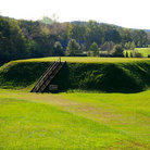 Picture - Green grass covers the Etowah Indian Mounds State Historical Site.