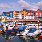 Picture - Boats and colorful buildings in the marina at Exmouth.
