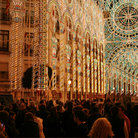 Picture - Street lit up at night curing the Fallas festival in Valencia.
