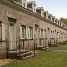 Picture - Old colonial row housing in Allaire State Park.