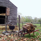 Picture - Firewood cart with a barn in the background, Allaire State Park, New Jersey.
