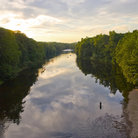 Picture - A fisherman in the calm waters of the Farmington River.