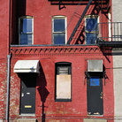Picture - A brick building with exterior fire escape in the Fell's Point area of Baltimore.