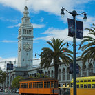 Picture - Historic San Francisco street cars in front of the Ferry Building.