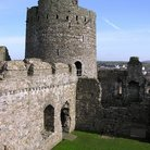 Picture - Wall and tower of Kidwelly Castle.