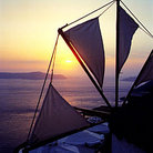 Picture - Windmill at sunset in Fira on Santorini.