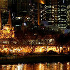 Picture - Flinders street at night in Melbourne.