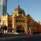 Picture - Lavish stone facade and copper dome of the Flinders Station in Melbourne.