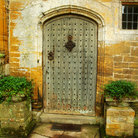Picture - Old wooden door at Forde Abbey in Chard.
