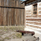 Picture - Wooden fence and building at Fort Calgary.