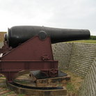 Picture - A canon along a wall at Fort Moultrie National Monument.