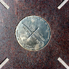 Picture - Four Corners survey marker where Colorado, Utah, New Mexico and Arizona meet.