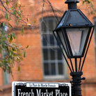 Picture - A sign on a lamp post for the French Market Place in New Orleans.