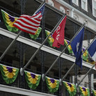 Picture - Flags flying off a balcony in the French Quarter, New Orleans.