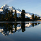 Picture - Mount Garibaldi reflected in calm waters.