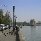Picture - The Gateway of India next to the red-domed Taj Mahal Hotel.