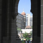 Picture - The red-domed Taj Mahal Hotel from th arches of the Gateway of India.