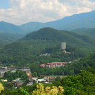 Picture - Town of Gatlinburg surrounding by rolling mountains.