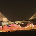 Picture - The lights at night on the Pyramids of Giza.