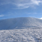 Picture - The snow covered summit of Glenshee.