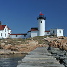 Picture - The white Eastern Point Lighthouse in Gloucester.