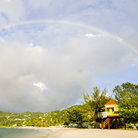 Picture - A rainbow over the beach at Grand Anse Bay.