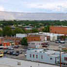 Picture - The town of Grand Junction with cliffs in behind.