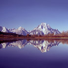 Picture - Tetons reflecting the water at Grand Teton National Park.