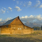 Picture - Barn bathed in sunshine on the grasslands in Grand Teton National Park.